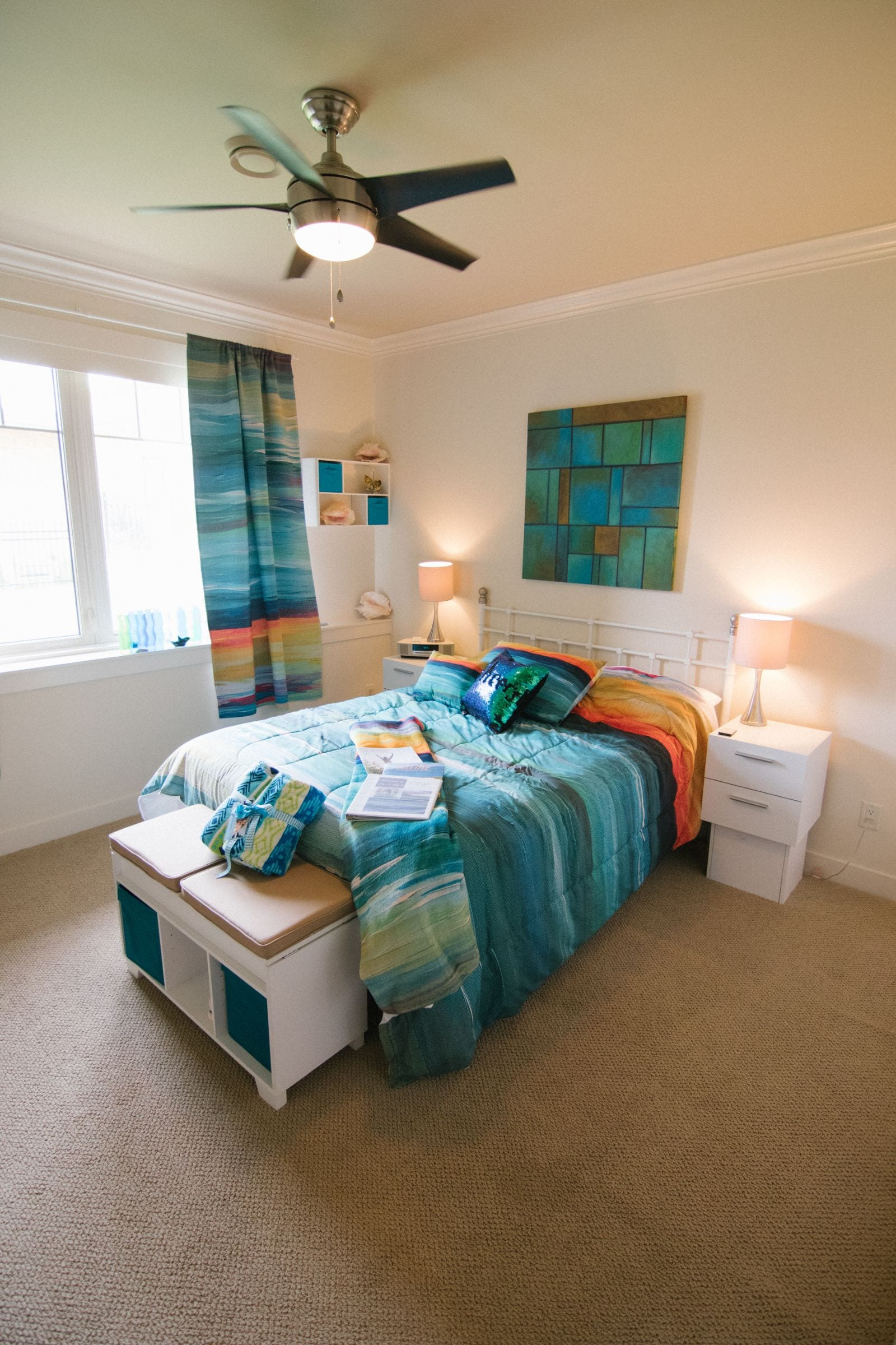 Bedroom with a window and ceiling fan