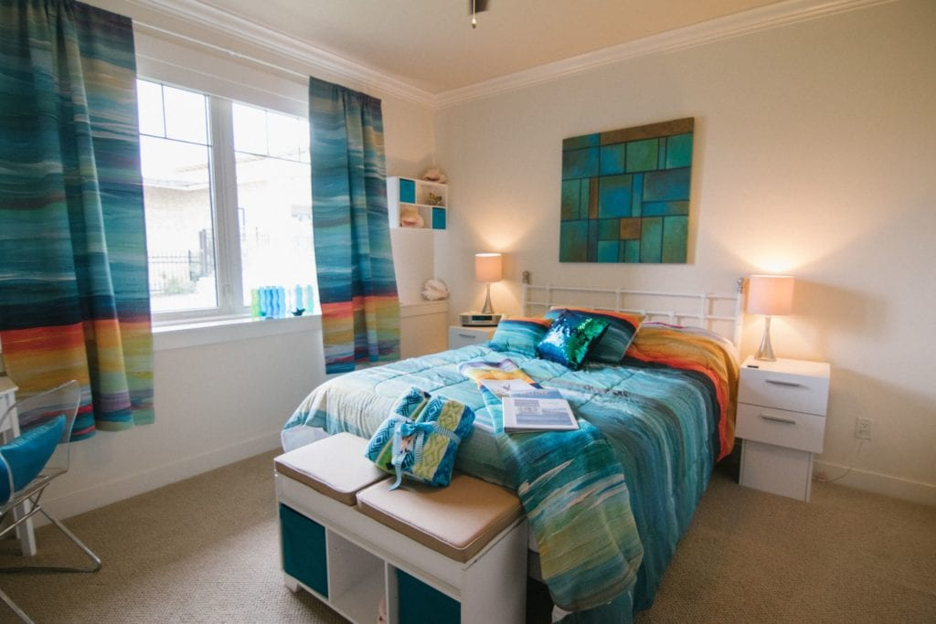 Full bedroom with window and lamps